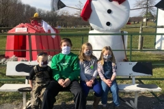 family-with-straw-snowman