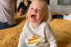 happy-girl-in-corn-crib